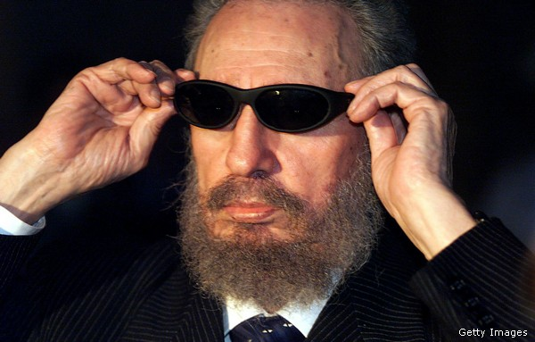 Cuban president Fidel Castro tries on a