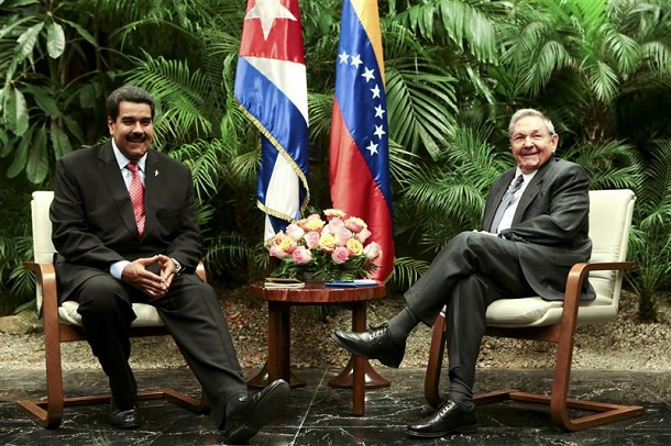 Venezuela's President Maduro speaks with Cuba's President Castro during their meeting in Havana